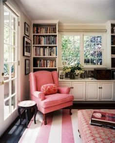 Built-ins around the window in dining room used for china storage and display rather than books