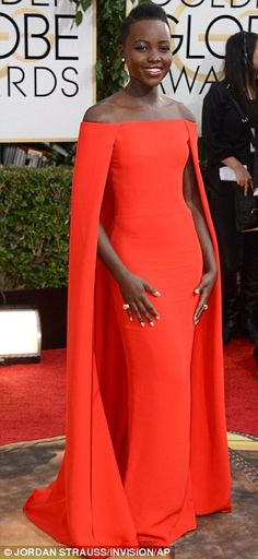 Lady in red: Nominated Lupita Nyong'o sported a sleeveless red Ralph Lauren gown, complete with cape detail #goldenglobes
