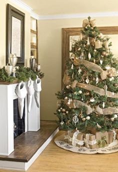We love the earthy feel the burlap adds to this tree. Click to get more Christmas tree decorating ideas.
