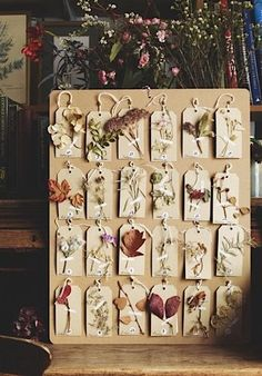 A floral advent calendar by sonia patel ellis from the herbarium project theherbariumproject com for the december 2015 issue of gardens illustrated photo by andrew montgomery Decoration Shabby, Diy And Crafts, Arts And Crafts, Deco Nature, Pressed Flower Art, Nature Journal, Nature Crafts, Flower Crafts, Dried Flowers