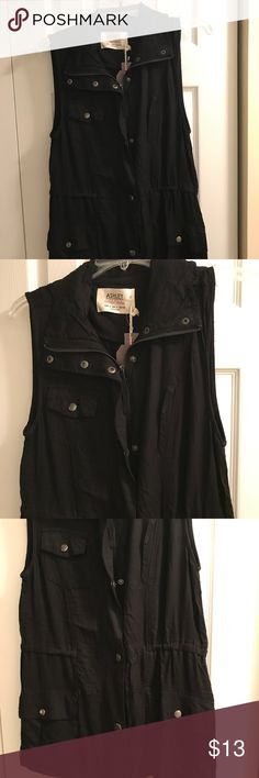 Black Cargo dress vest Never been worn. Black Cargo Vest 28 inches long from shoulder. Size Small Tops
