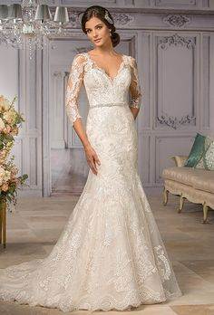Jasmine Couture. Stunning illusion lace back and neckline are paired with a perfect fit-and-flare skirt.
