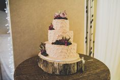 Blush petal iced wedding cake with blackberries and purple flowers    Photography by http://marymcquillanphotography.com/