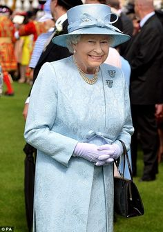 Both the Queen and the Duke appeared to be in good spirits at they enjoyed a nice June day at Buckingham Palace for a garden party ~~ June 10, 2014.