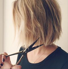 Lauren Conrad goes from a swingy lob to an above-the-shoulder bob.
