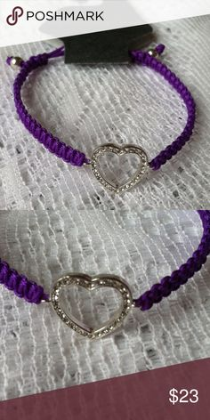 NEW Purple CZ Heart Cord Adjustable Bracelet Brand: unbranded   Condition: Brand new with attached tags.   Size: One size fits most/adjustable.  Color: Purple & silver  Material: silver plate unbranded Jewelry Bracelets