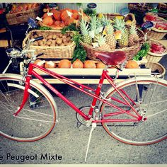 My red Peugeot Mixte. Vintage 1983. Ride Bicycle in Ravenna-Seattle accessorized it. They added Velo Orange fenders, Velo Orange Racks, Brooks Saddle. I love this feisty show stopper bike!