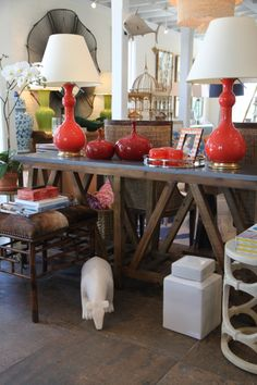 Red #Spitzmiller #lamps and #vases are the perfect contrast to natural #wood #console at #Mecox #Southampton #interiordesign #MecoxGardens #Hamptons #furniture #shopping #home #decor #design #room #designidea #vintage #antiques #garden