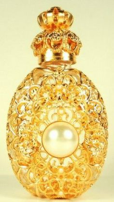 Gold tone filigree perfume bottle