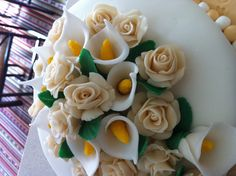 Rose and calla lily flowers made with gum paste.