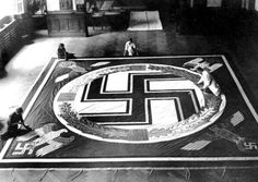 German textile workers prepare Adolf Hitler's official standard for the Reichsparteitag.