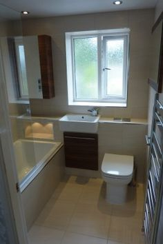 Ideal small bathroom layout only. Sink next to bath. Chrome wall radiator by door. Tiles & colour let it down. Small Bathroom Layout, Small Bathroom Storage, Simple Bathroom, Bathroom Ideas, Small Bathrooms, Bathroom Organization, 1950s Bathroom, Small Baths, Narrow Bathroom