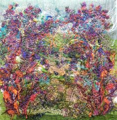 "Created with fabrics, fibres, threads, free motion stitching and water soluble stabilizer. 6"" x 6"" ""Wild Garden"""