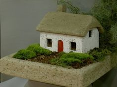 Irish Cottage w/ Red Door by Dixie's Brookfield Garden. $225.00. Great for the miniature gardener or fairygarden enthusiast. Real wood door and metal window grids. Roof is removeable making it easy to install a light source or use with a candle as a lantern. This handmade cottage is the essence of a simple country house in Ireland.. This cottage is a unique focal point for the garden.. This cottage is handmade in the U.S. of durable hypertufa concrete. Each cottage is pai...