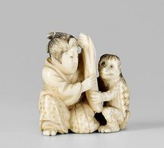 An ivory netsuke of a young man and a kappa, by Tomochika. Late 19th century