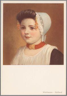 Meisje in Walcherse streekdracht. Aan de krullen van het oorijzer hangen…