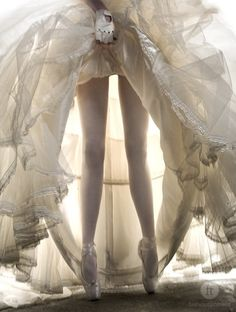 I like the light and the unexpected angle of legs under a dress