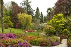 Top 10 Gardens to Visit for Spring Flowers: Powerscourt - Tucked in the hills of County Wicklow, Ireland, Powerscourt is a sprawling estate overlooking Sugarloaf Mountain. Italian, Japanese and English style gardens slope down from the manor. Come in springtime to enjoy the rhododendron, narcissus, wisteria and azalea blooms, the fluttering cherry blossoms and African lilies. Your camera shutter will tire at this gorgeous location!