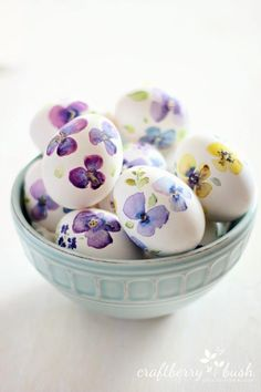 Painted Watercolors - 21 Easter Egg DIY Ideas That Are Oh-So-Cute and Easy - Southernliving. These pansie watercolor Easter eggs are a great way to welcome spring.  See the process here.