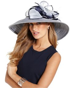 Exquisite stripes and flirty bow accent adorn this navy and white hat from August. Available at Macy's.