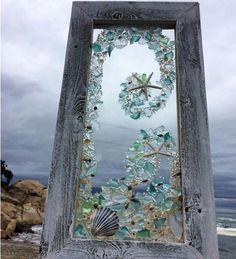 Sea glass and shells on an old window! Beautiful!