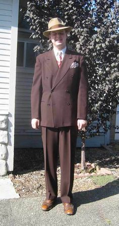 1940's double-breasted suit and fedora.  I own a suit nearly like this.