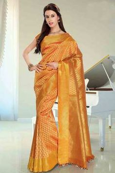 Tumeric yellow silk brocade zari weaved saree in golden border