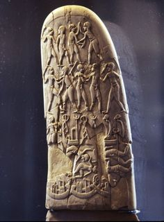 Handle of a knife carved with battle scenes, from Gebel el-Arak, Naqada II, Prehistoric Egypt, ca. 3500-3100 BC, (flint and hippopotamus ivory). Now at the Louvre.