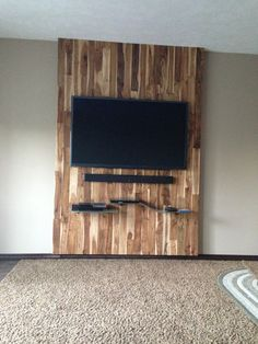 Wood Feature Wall reclaimed wood feature wall and custom branded lightbox. interiors