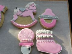 Sugar cookies baby gears  Rocking horse, rattle, pacifier and booties. By Baked Ambition.
