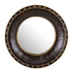 Lend a touch of handsome appeal to your living room or master suite with this stylish wood wall mirror, showcasing a faux leather overlay and nailhead trim. ...