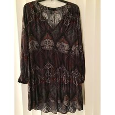 Loose fitting dress I bought this dress, and decided to never wear it but I have lost the tag and cannot return it! So it is never worn, (the tag connected is still on the label) and in great condition! Size XS but fits loosely. Beautiful purple design! Sanctuary Dresses Long Sleeve