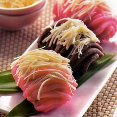 This is Getuk Lindri. One of traditional kueh from Indonesia. Getuk Lindri made from cassava. getuk lindri have sweet and savory flavors suitable for afternoon snacks while drinking tea