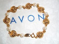 "Vintage Signed Avon ""Pearly Heart Bracelet"" ~ embossed gold-tone hearts alternate with faux pearls by BeccasBestJewelry on Etsy"