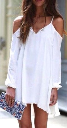 White dress + embroidered clutch.