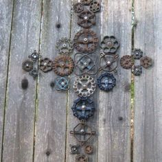 Cross yard art made from old knobs, drawer pulls, gears, etc.