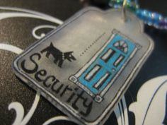 Jewelry for your pet Security Dog Door Barker by scrappyrat