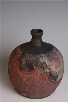 Carved raku bottle.  www.nitaclaise.com