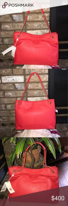 TORY BURCH MARION CHAIN SHOULDER SLOUCHY TOTE🌹🌹 this TORY BURCH MARION CHAIN SLOUCHY TOTE is so AMAZING it is BRAND NEW WITH THE TAGS STILL ON!! This TB bag is also a amazing red color, TB calls it MASAAIRED ! This Slouchy Tote can be worn as a shoulder bag with the chain doubled or sos a CROSS BODY with using the vain as one. Two purses in one😍😍 The inside is almost as nice as the outside  there is s zippered compartment in the middle and a zippered pocket on the side. Alone with many…