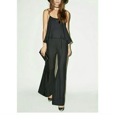 SHOW ME YOUR MUMU danni jumpsuit Black silky satin blend. Features adjustable shoulder straps, elastic waistband, back cut out with button closure. New with tags. PRICE IS FIRM Show Me Your MuMu Other