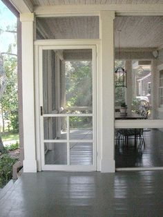 "Such a welcoming porch...just seems to say ""come on in"". I would add some pretty potted plants."