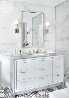 The porcelain wall and floor tiles in the master ensuite have a tasteful Old World feel that's elevated by the mix of tiles and materials.   Image: Stephani Buchman