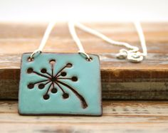 Clicked it!  Also, I really like this piece...  Dandelion - custom color enamel pendant necklace on sterling silver chain.. $59.00, via Etsy.