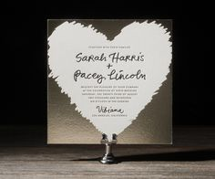 Looking as though a scratch-off lottery ticket just invited you to an amazing wedding, Jessica Tierneys Urbanic design is a lighthearted and whimsical take on letterpress invitation design. For this invite were picturing a post-industrial loft sort of space with lots of exposed brick and big old-growth beams.