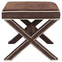 "Nailhead-trimmed ottoman with X-shaped legs.   Product: OttomanConstruction Material: Birch wood and polyesterColor: Chocolate brownFeatures: Nailhead trimDimensions: 19"" H x 21.5"" W x 21.5"" D"
