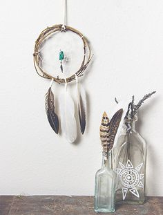 SOUL AWAKENING DREAM CATCHER This absolutely stunning 6 inch dream catcher is *hand crafted*, using sticks and twigs with a white inter weaving and a vibrant turquoise nugget.