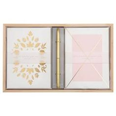 Bring some style to your workspace. Featuring a dynamic duo of designs, with gold foil details, a wooden tray to organize your desktop and a gold-toned ballpoint pen to share your thoughts. Premium card and envelope paper stocks. Blank inside.