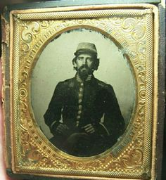 A sixth plate ambrotype of a Confederate Captain with three bars on his collar.  This image surfaced out of Louisiana.  The soldier has that Louisiana look with the dark uniform and grey cap.