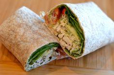 Greek yogurt pesto chicken wrap. 851 kcal (Higher calories due to pesto). Portion on http://www.fitlessflavor.com/week-2-meal-plan/
