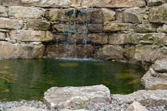 This is an amazingly tranquil pond setting, surrounded by a large natural stone retaining wall architectural designed feature. The waterfall was designed and constructed to be fully contained and functional all year long. The waterfall and pond can be enjoyed everyday of the year, full of fish completely worry free of Colorado's harsh elements.